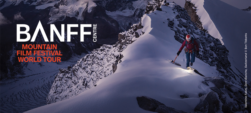 Graphic advertising the Banff Center Mountain Film Festival World Tour. A mountaineer climbs up a snowy mountain at dawn or dusk.