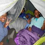 5 Ethiopian teens sleeping in a 3-man tent. Thanks Eureka!